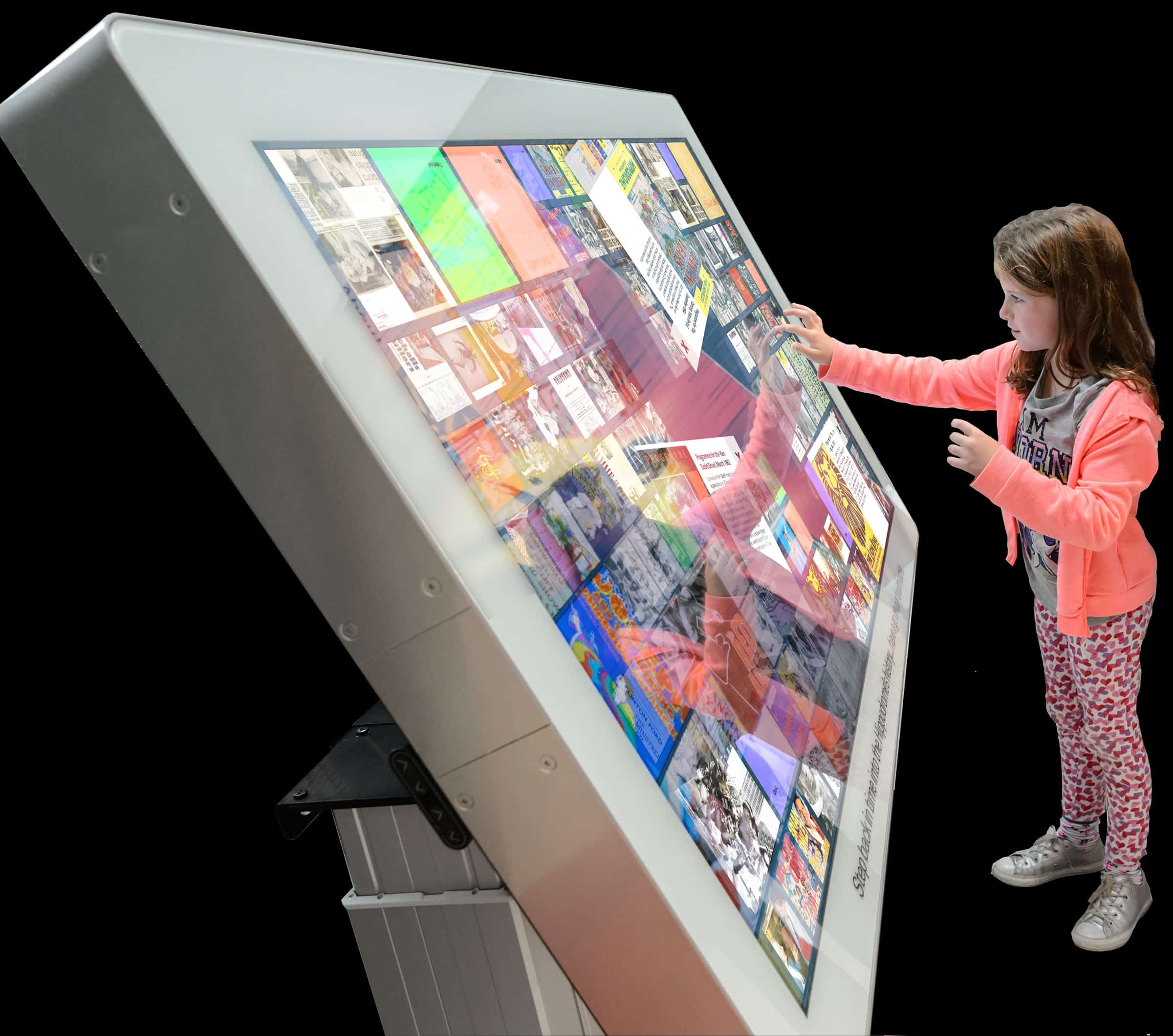 A girl uses the touch table in tilted position at Birmingham Hippodrome