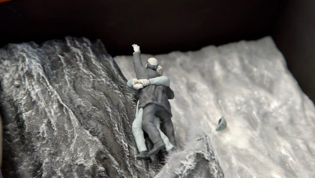 miniature figures on a waterfall